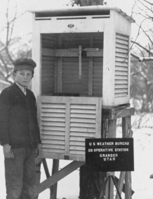 Young child standing next to an instrument shelter