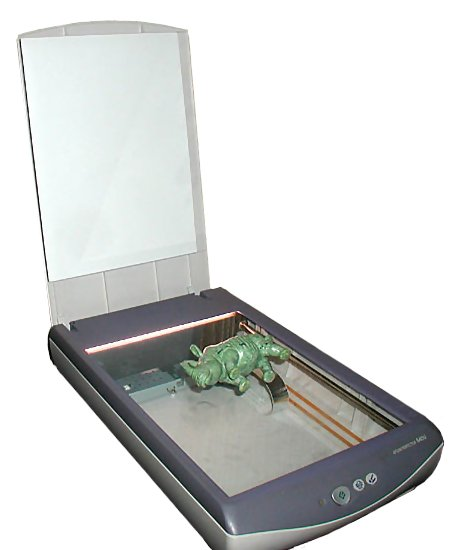 Photo of a scanner with a toy rhinoceros on it
